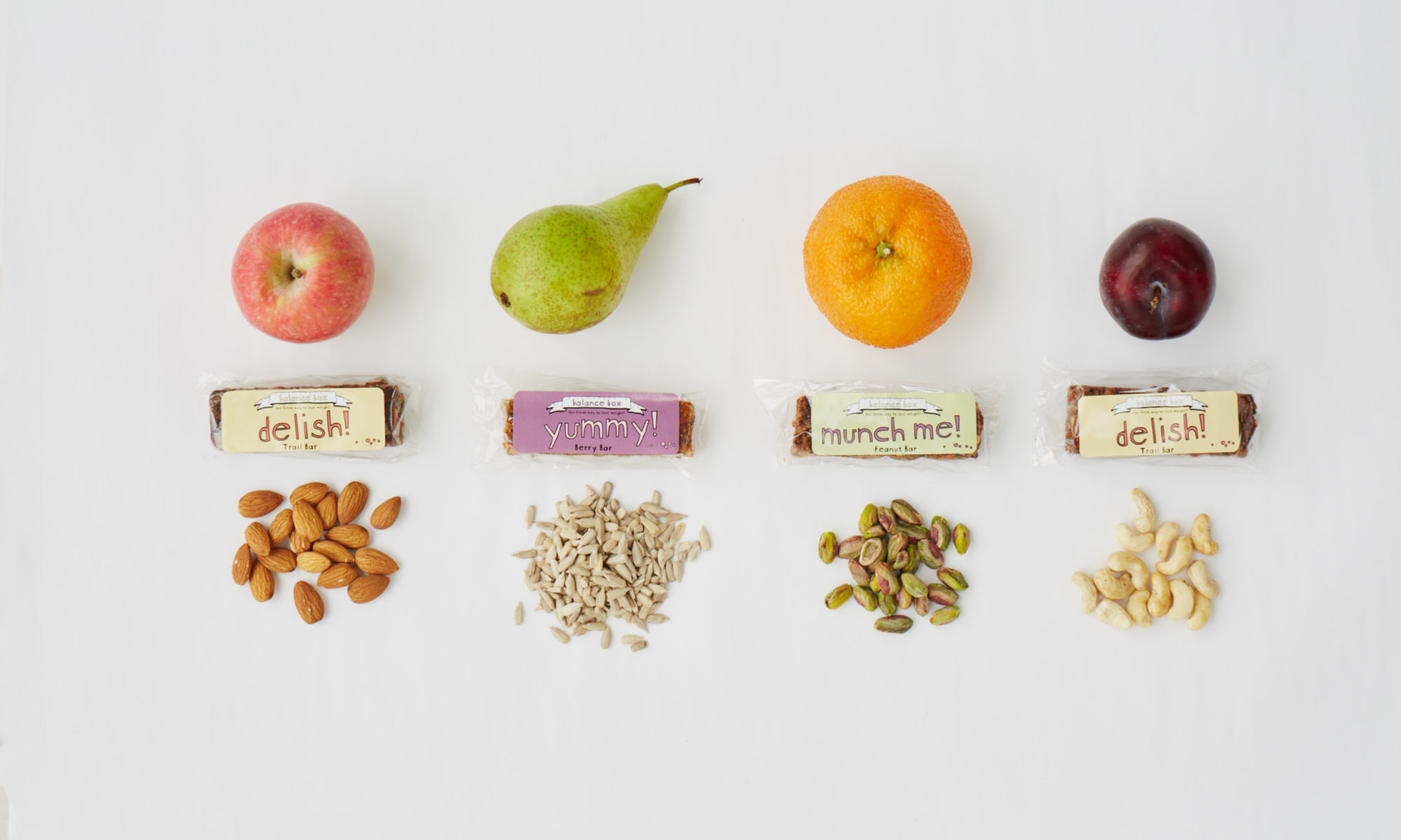 Fruit, nuts, seeds and energy bars lined up