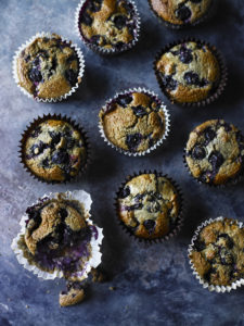 Blueberry oat muffins all laid out on a worktop