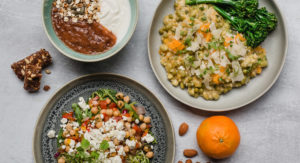 A Balance Box balanced diet including Roasted Plum Bircher, Chickpea Chilli & Feta Salad and Butternut & Edamame Bean Risotto