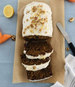 Carrot cake on blue background